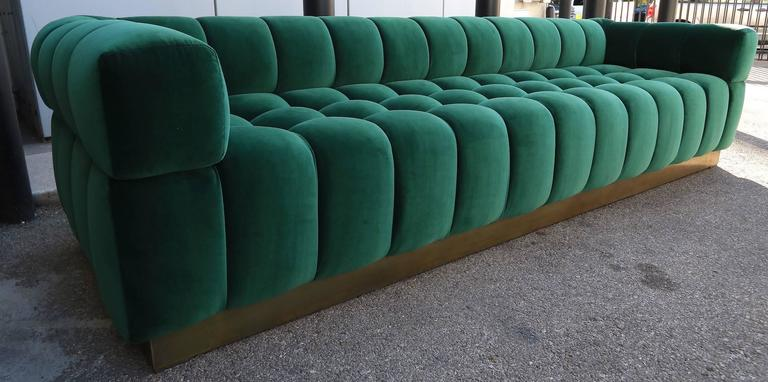 Custom tufted sofa with brass base, in dark green Belgium velvet. Can be made in different colors and fabrics or a different metal for the base.  A charcoal brown version can be seen at #LU8175877915.