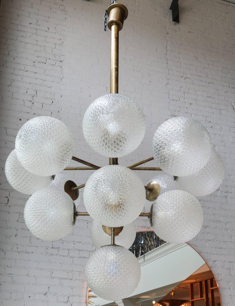 Large chandelier with brass frame and 13 pebbled glass balls (11