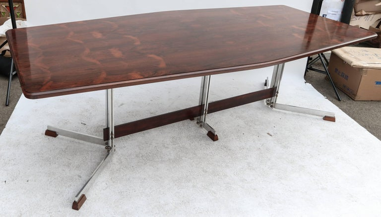 Liceu de Artes 1960s dining table for eight in Brazilian jacaranda with chrome and jacaranda base.  Width at ends:  36