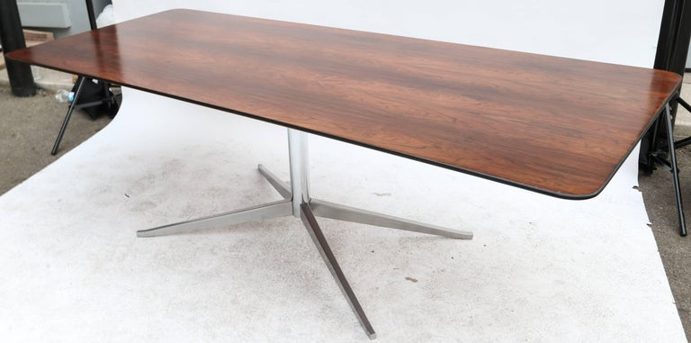 Brazilian jacaranda dining table by Forma from the 1960s with chrome pedestal leg.