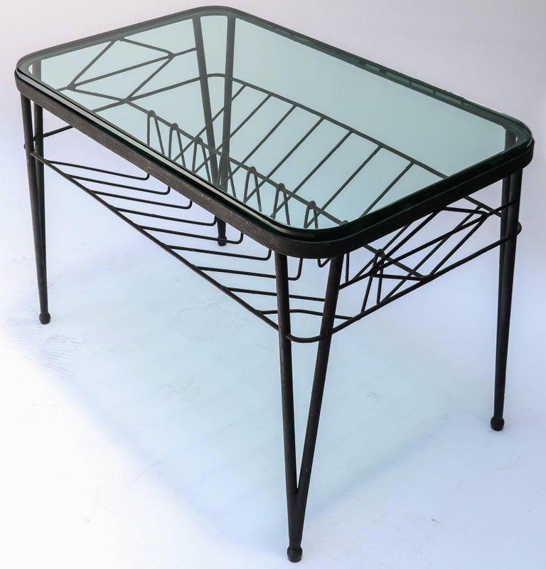 Rectangular black metal Italian side table from the 1960s with glass top.