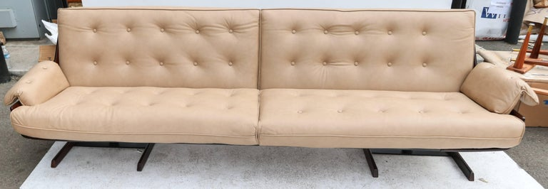 1960s sofa by Novo Rumo in Brazilian jacaranda and upholstered in beige leather.