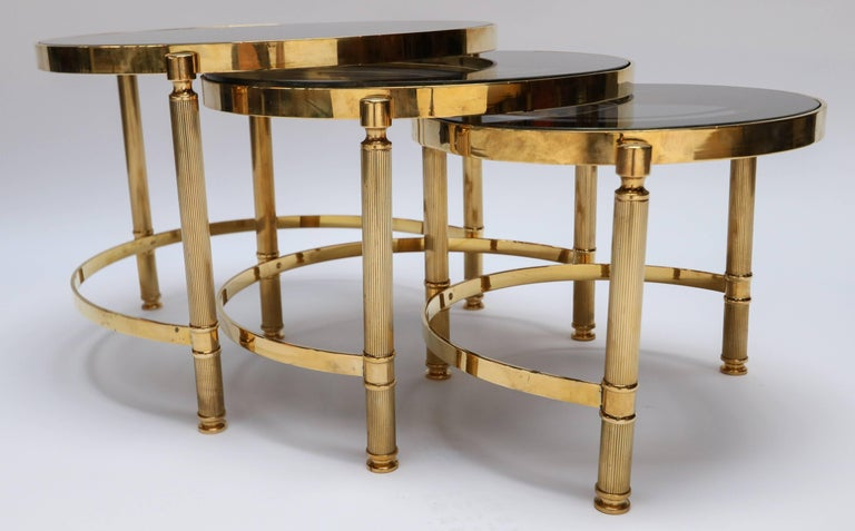 Italian Set of Three Brass Nesting Tables with Smoked Glass Tops For Sale