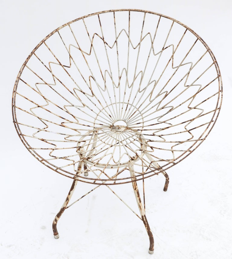 Pair of round bowl shaped metal outdoor or garden chairs.