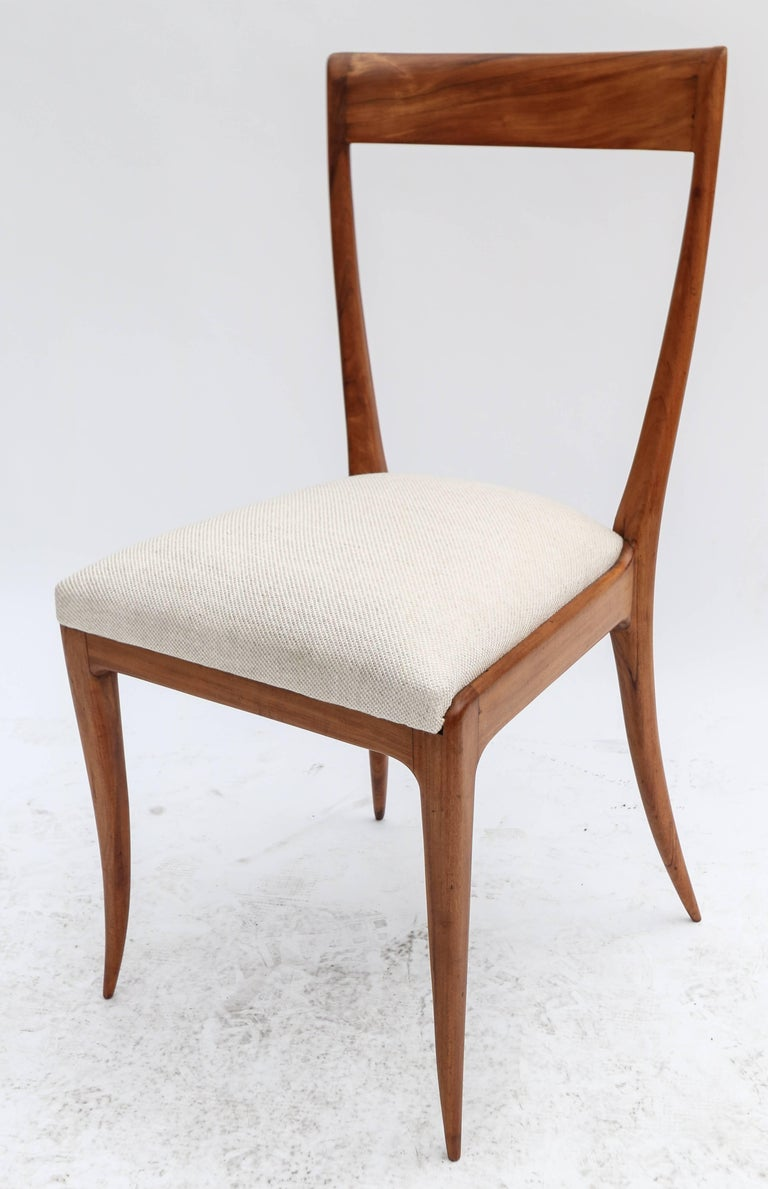 Set of eight Scapinelli 1960s dining chairs in Brazilian caviuna wood with beige linen upholstery.