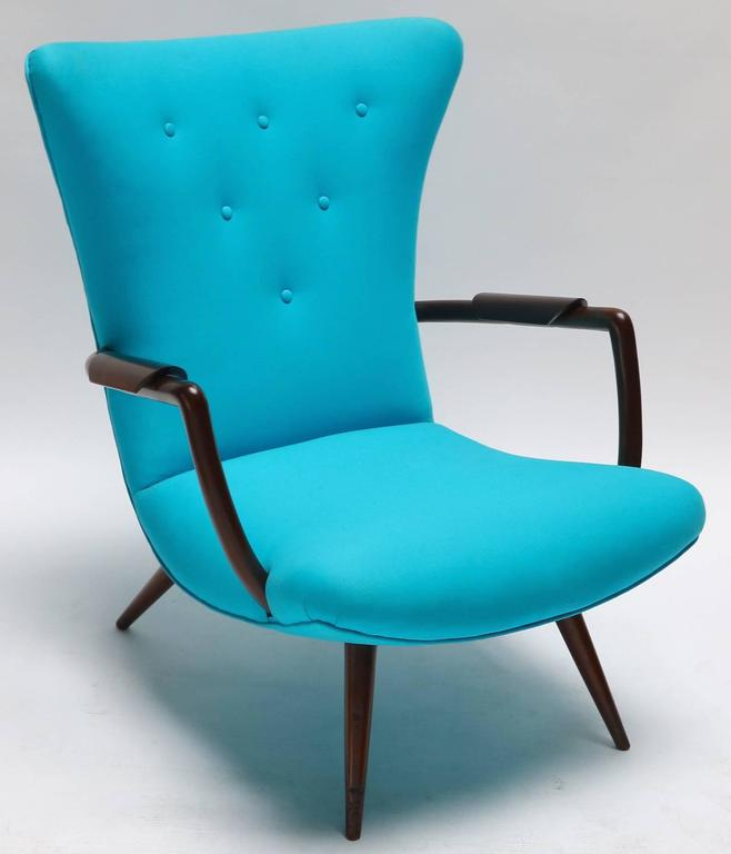 Pair of Brazilian Paulistana armchairs in the style of Giuseppe Scapinelli with unique wood armrests upholstered in turquoise blue twill.