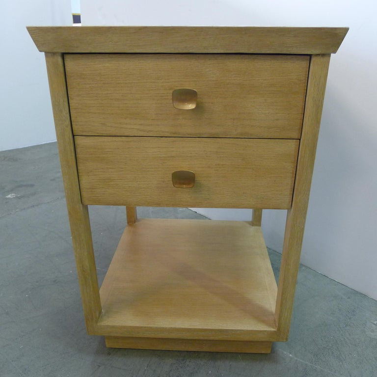 Paul Marra two-tier nightstand in rift sawn oak natural finish. Finish coloration varies with lighting/natural lighting, see all photos. Two drawers with satin brass handles. Shelf. Banded top. By order.