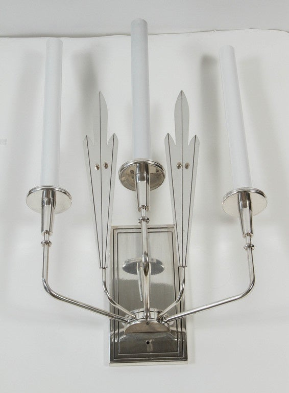 Vintage Mid-Century Parzinger style large-scale pair of silver plated sconces. These are vintage condition with patina, aging and minor losses to the original finish. Newer electrical.