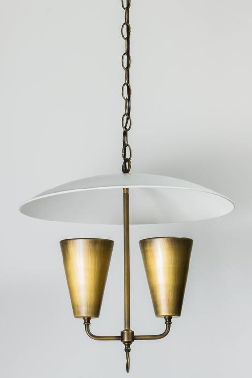 Mid-century brass pendant, Lightolier style, dome-shape. Restored with new finish and electrical. Total drop height with canopy, chain, fixture is 52 inches.