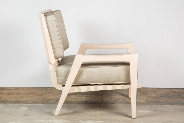 Paul Marra Low Lounge Chair shown in bleached maple and linen upholstery, Mid-Century Modern style. There is a pair in stock, price quoted is per chair. Also can be ordered. Production lead is approximately 4-6 weeks. Measures: Seat is 24.5 D, 24 W,