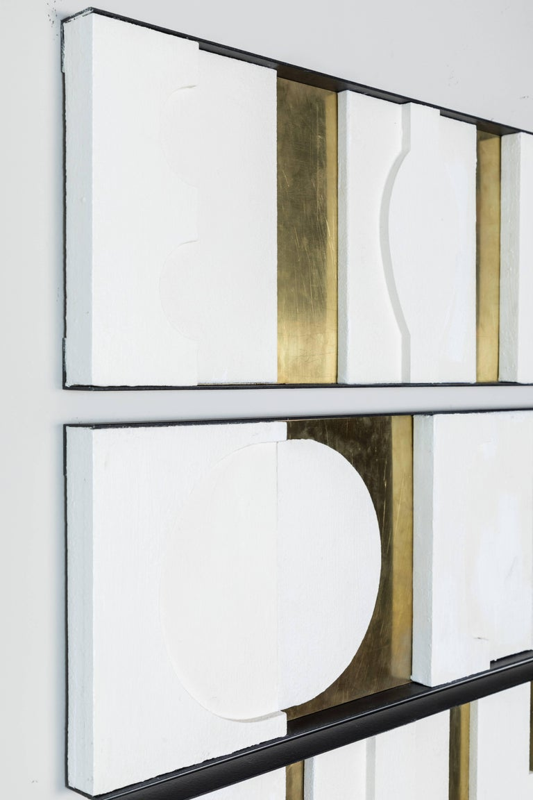 Architectural, series of three decorative art wall panels with brass and gesso relief by Paul Marra. Each panel is one foot high, as shown the total height as displayed is 39 inches. The framing is steel with oil-rubbed bronze finish, the brass