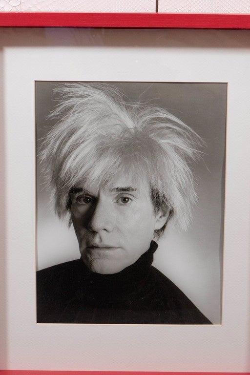 Andy Warhol in red shadowbox frame. Signed and stamped on the reverse.