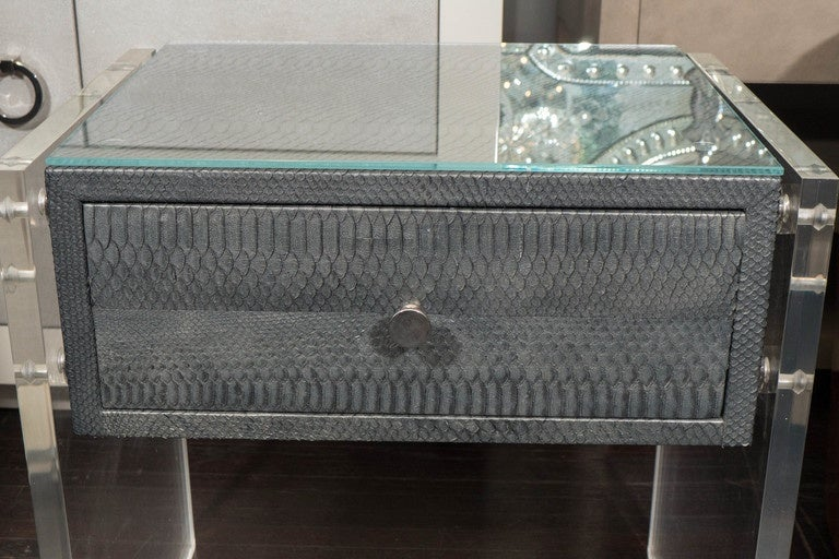 Custom pair of gunmetal gray python nightstands with Lucite side panels.