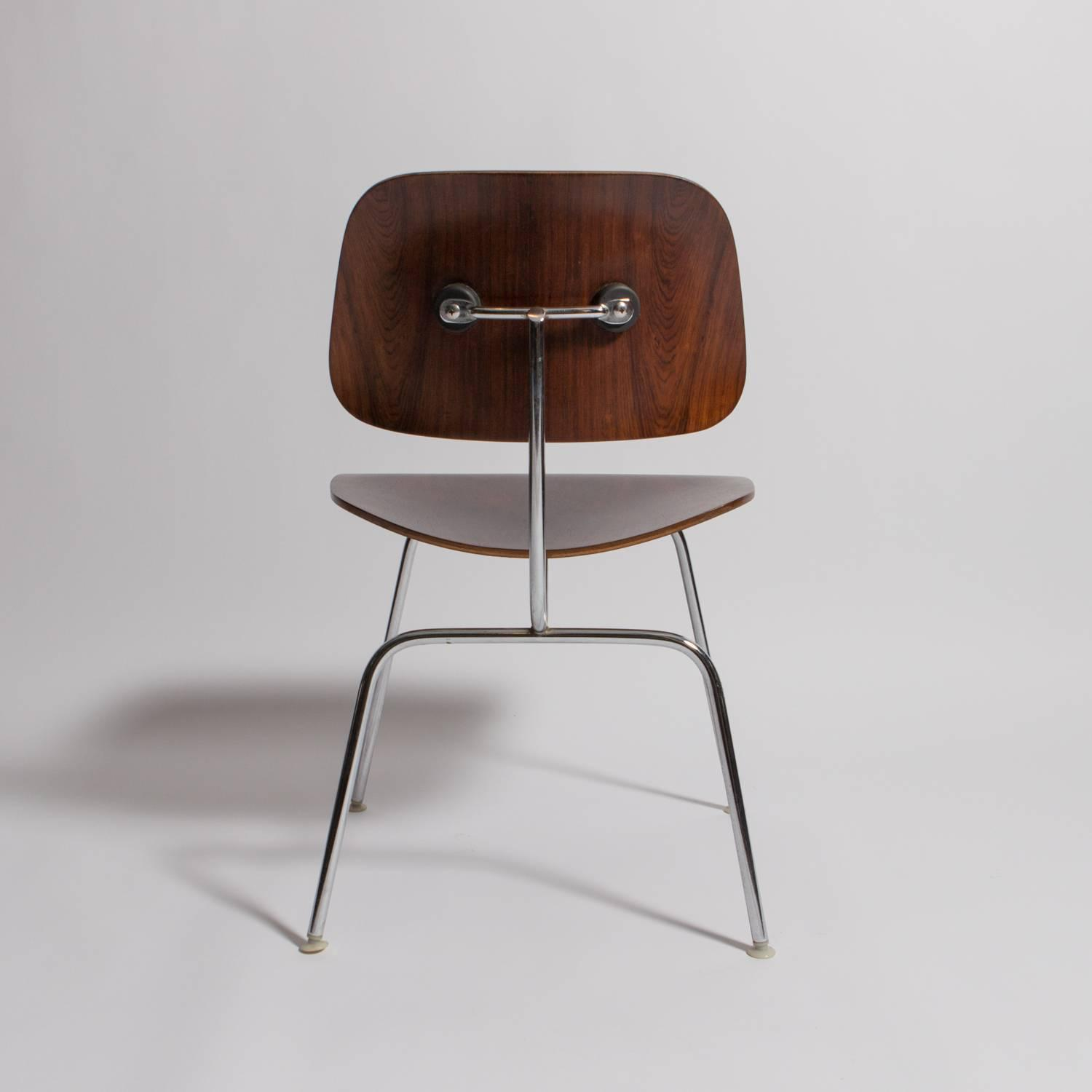 charles eames rosewood dcm chair manufactured by herman miller for
