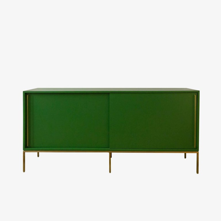 Mid-Century inspired credenza series from reGeneration. Lacquered case available in a range of colors on brass satin nickel or powder coated base. re: 379.