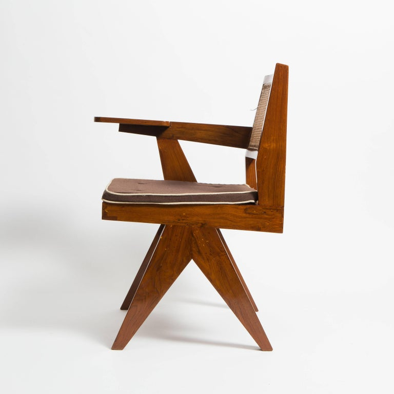 Pierre Jeanneret library chair which was designed for the Panjab University Library reading rooms but also for other libraries of the city Chandigarh. The chair is made out of solid teak and cane.