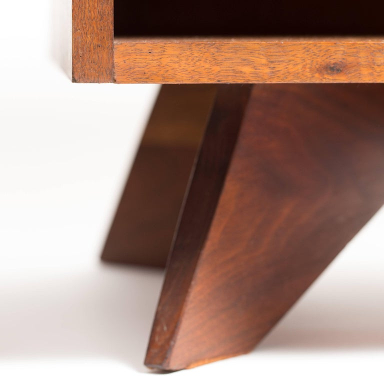Pair of sculptural, George Nakashima walnut bedside tables, mfg. Widdicomb.