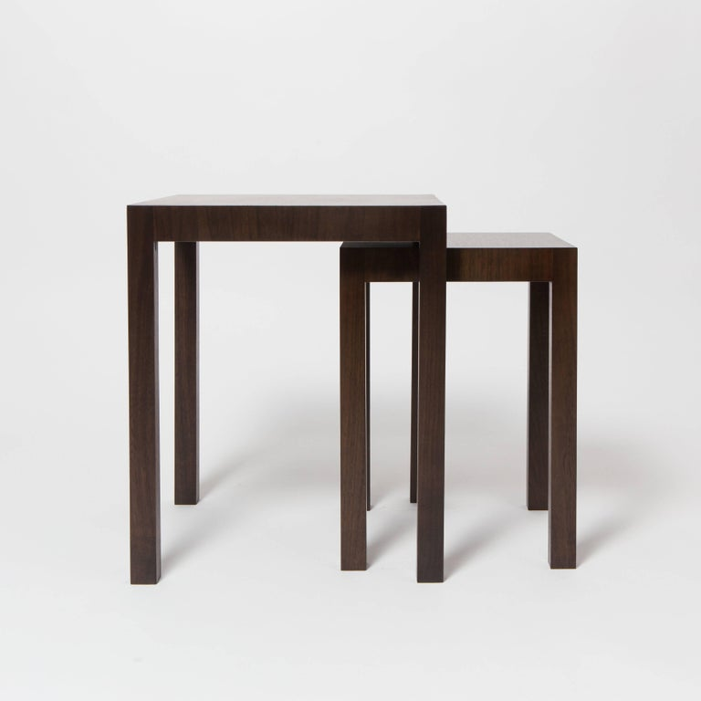 Two bespoke walnut nesting tables with third non