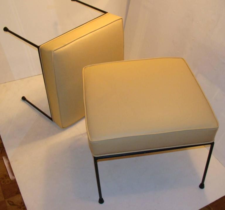Nice pair of vintage Paul McCobb iron leg stools and newly recovered in leather.