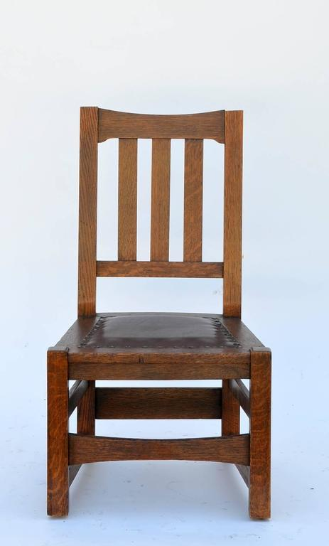 Petite Mission style Arts & Crafts low chair by Stickley Brothers.