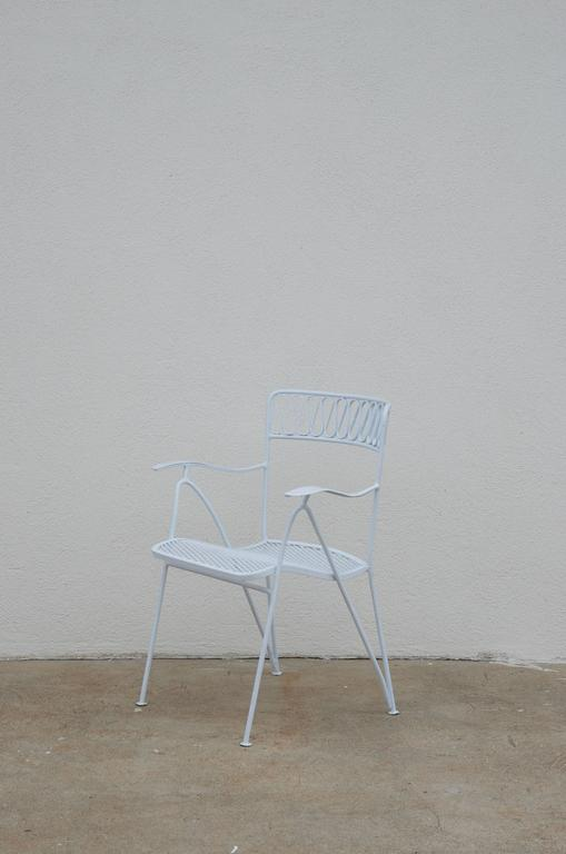 Set of six outdoor indoor dining chairs by Maurizio Tempestini for Salterini.  Two armchairs (25 in. wide at the arms) and four chairs (19 in. wide).