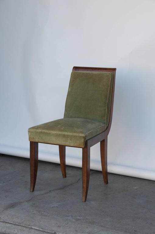 Elegant Art Deco mahogany side chair in the style of Jean Pascaud.