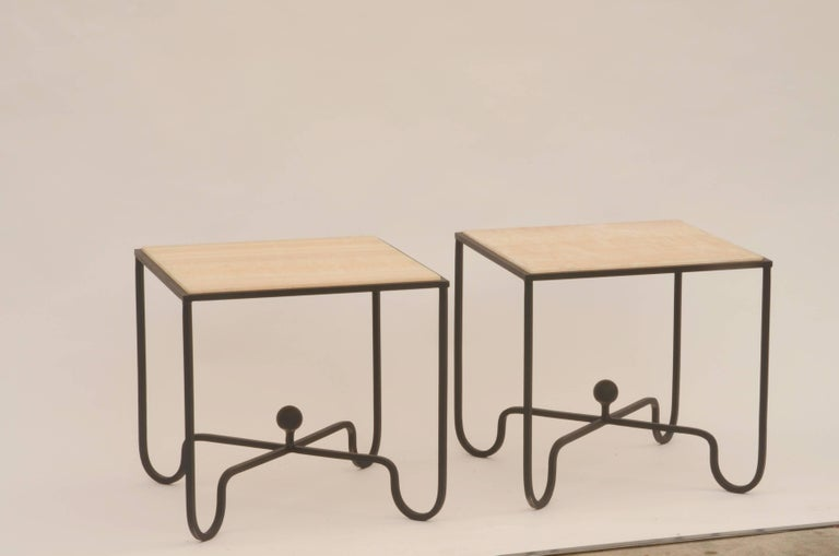Pair of 'Entretoise' wrought iron and onyx side tables by Design Frères. Great as end tables or as a two-part coffee table. In the style of Mathieu Matégot.