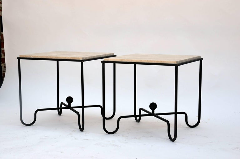 Pair of wrought iron and travertine 'Entretoise' side tables by Design Frères. Chic pair of versatile side or end tables. Also great as a two-part coffee table. Indoor or outdoor use.