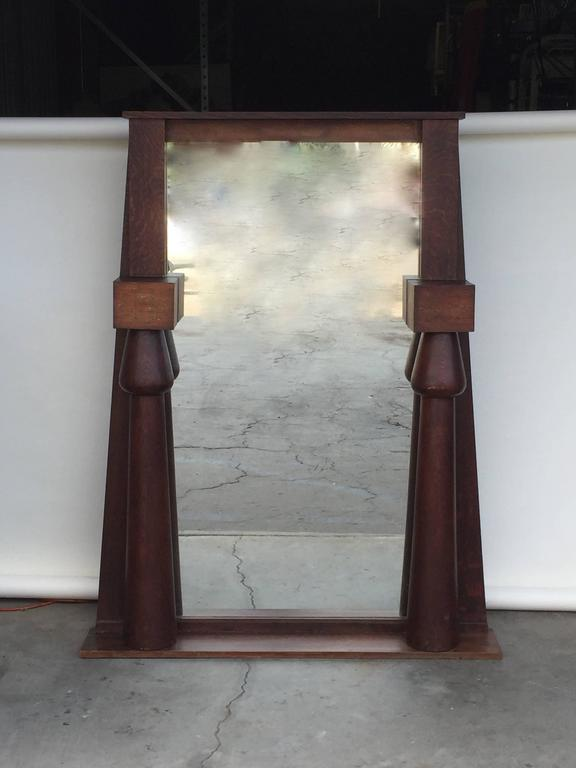 Impressive Egyptian Revival Arts & Crafts stained oak mirror. Perfect over a fireplace.
