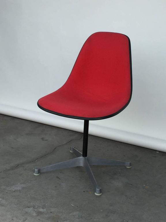 Single vintage fabric contractor base Eames swiveling chair. Perfect as a side chair or a desk chair. Stamped Herman Miller under the seat.