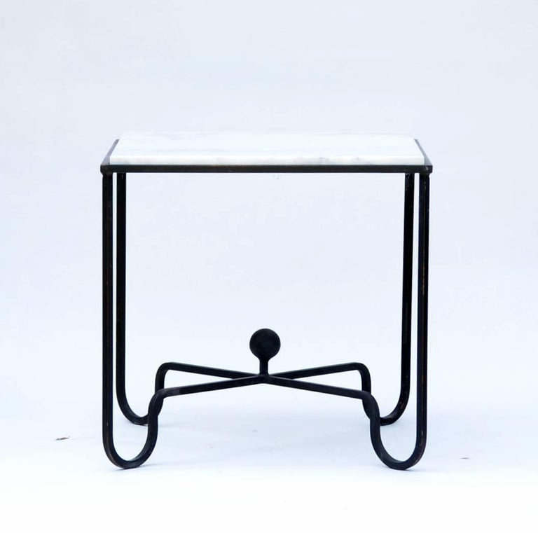 Pair of wrought iron and marble 'Entretoise' side tables by Design Frères. Chic pair of versatile side or end tables. Also great as a two-part coffee table. Indoor/outdoor use.