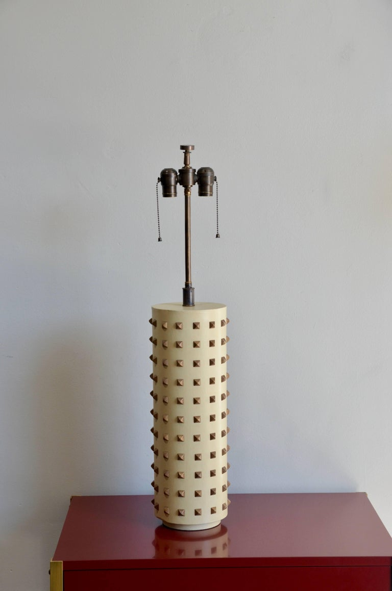 Large studded cylinder table lamp.