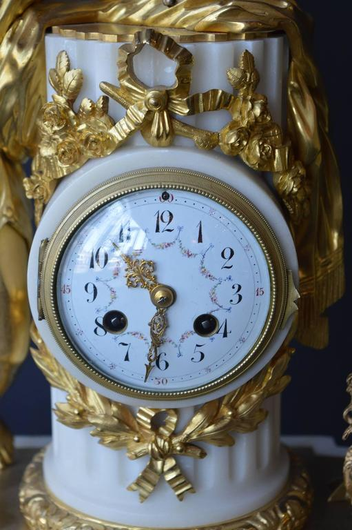 19th Century French Marble and Gilded Bronze Clock Set For Sale