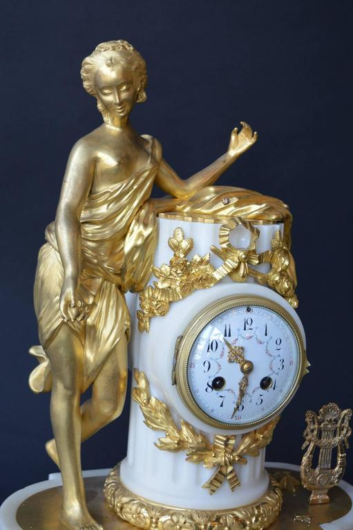 French Marble and Gilded Bronze Clock Set In Excellent Condition For Sale In Los Angeles, CA