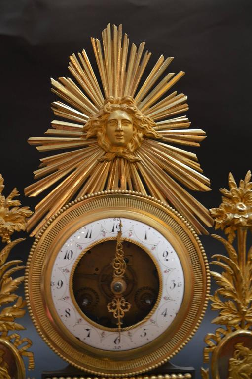 19th century sunburst clock. Bronze with marble base.