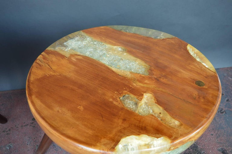 Pair of wood and resin side tables.