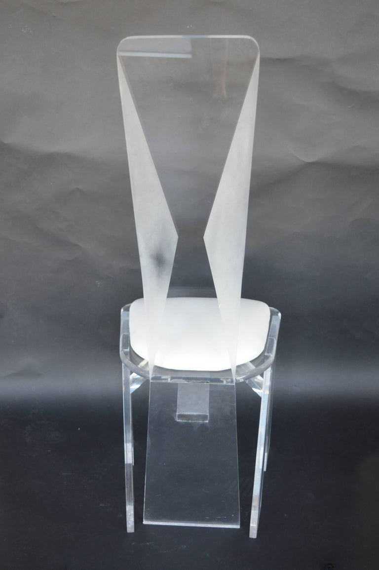 Set of eight Lucite dining chairs.