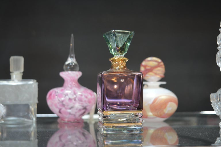 Collection of assorted designer perfume bottles, lalique and Murano bottles, French, and Italian.