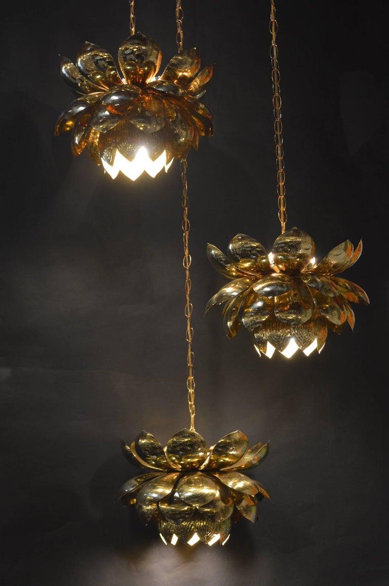 Brass pendant chandelier of Lotus Blossoms hanging. In the style of Feldman Lighting co.