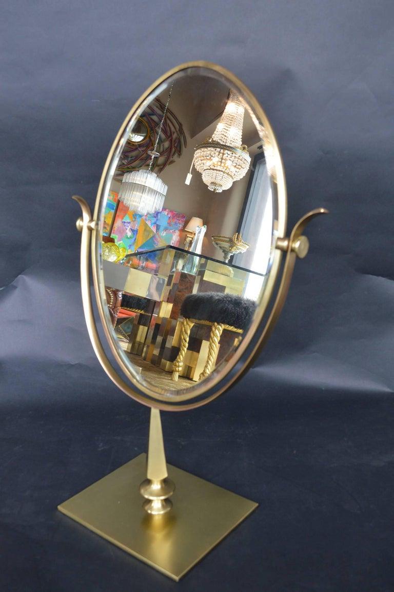Brass mirror by Charles Hollis jones.