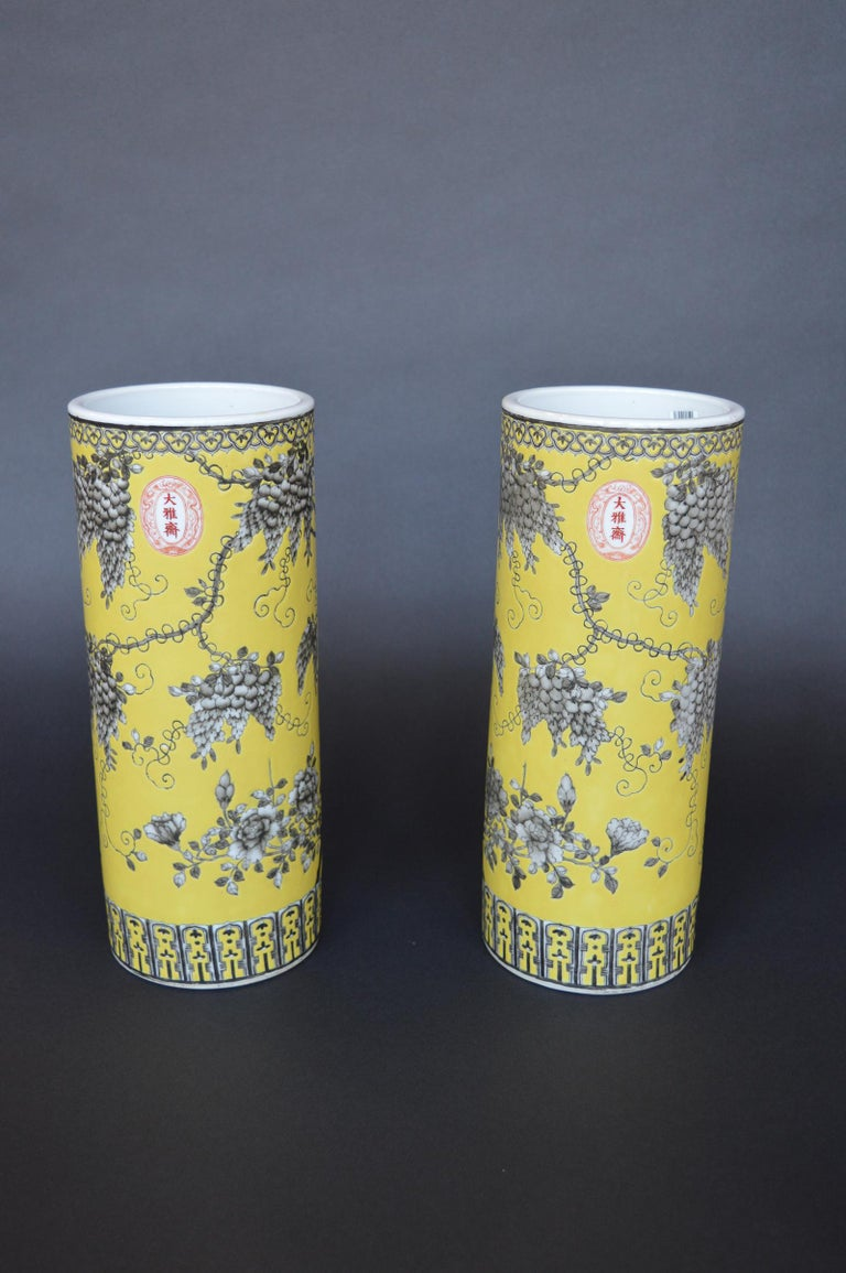 A pair of Dayazhai yellow-ground grisaille-decorated cylindrical vases.