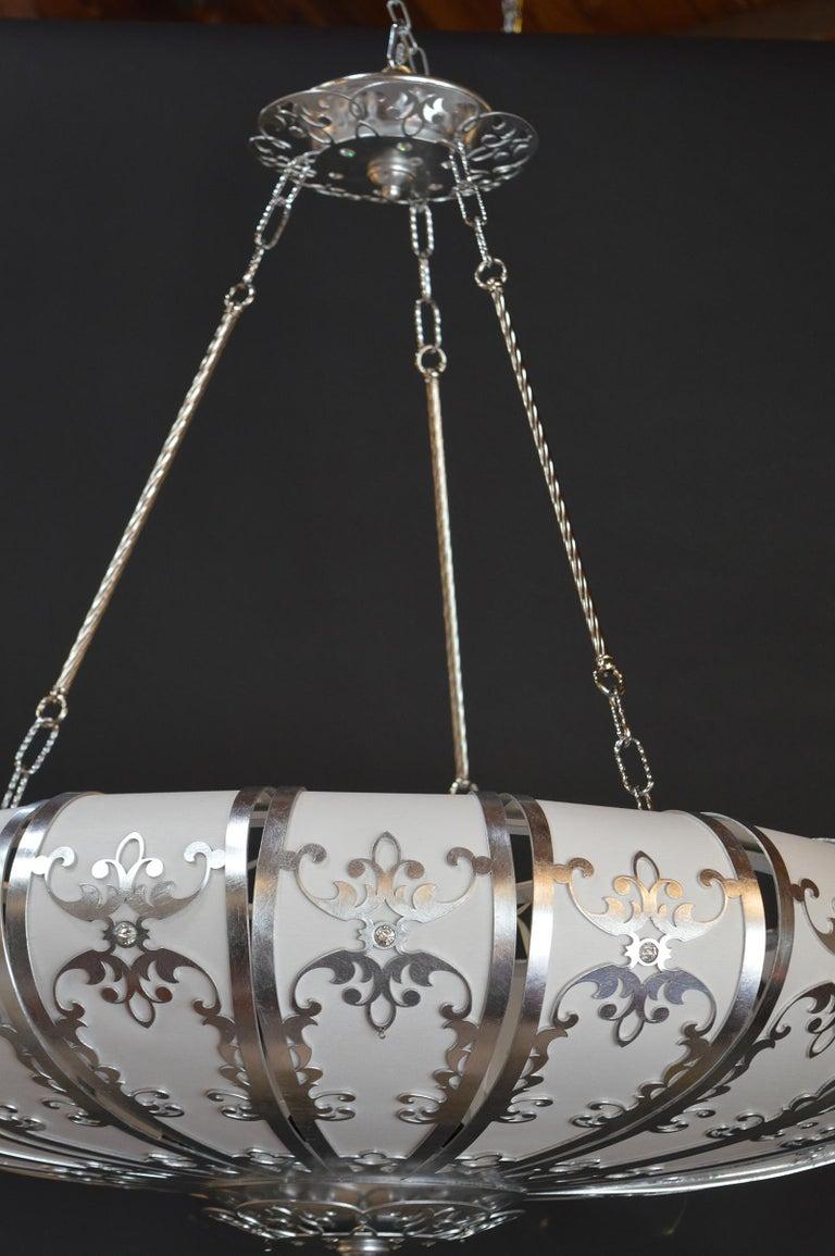 Silverleafed UFO style chandelier.