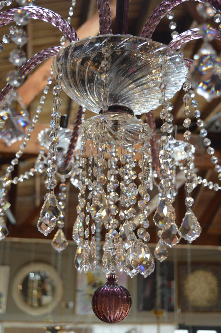 Purple Murano chandelier with crystals.