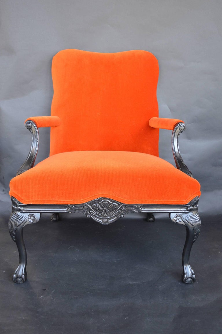 Pair of Chippendale style chairs. Upholstered in an orange corduroy. Black paint.