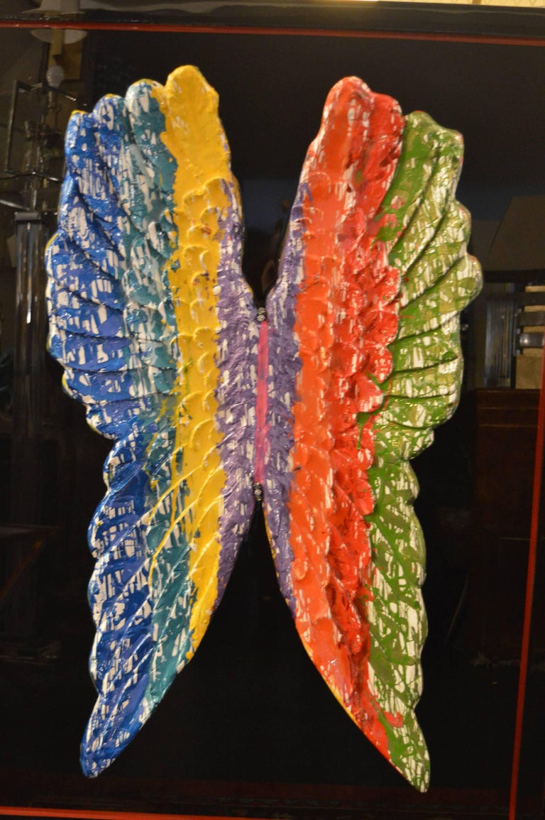 Paint dripped wings covered in resin.