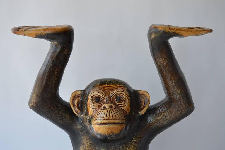 Papier mâché chimpanzee signed by Sergio Bustamante. Numbered 45/100. He can be placed under a console to look as if he is holding it up, but I would not suggest resting anything too heavy above him, he's very light weight and cannot handle too much