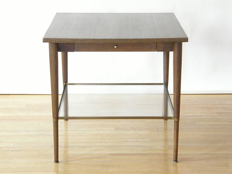 Side or end table with slender drawer and glass shelf designed by Paul McCobb. This piece is part of the Connoisseur Collection for H. Sacks and Sons.