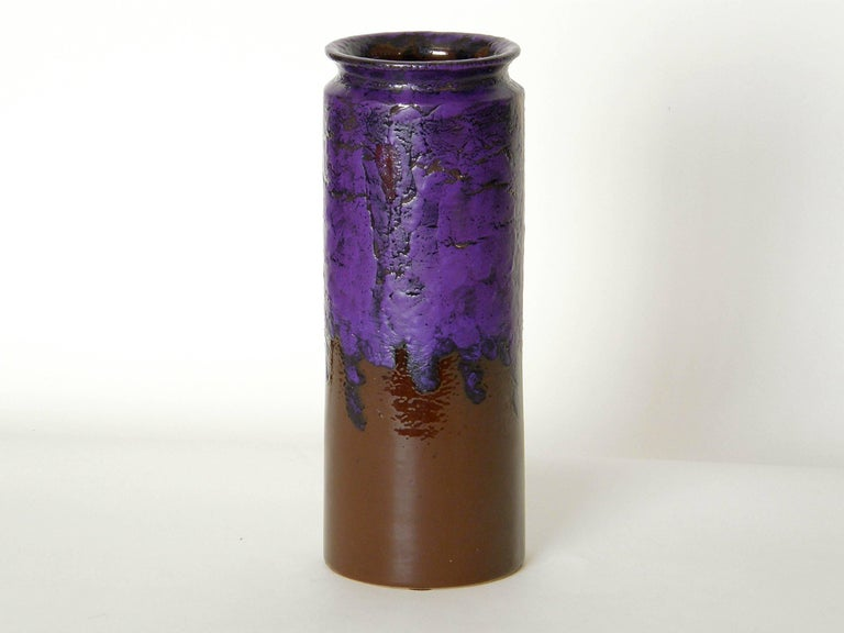 Ceramic vase made in Italy for Rosenthal-Netter. The vivid purple lava glaze with bright red accents flows down over the chocolate brown base color. This is a classic example of mid-century modern Italian pottery.