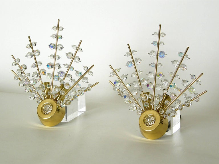 Dramatic and sparkling Sputnik wall sconces attributed to Bakalowits, Austria. The radiating spikes are laden with faceted crystals of different sizes. They are lit from behind, and each sconce has two sockets.   These sconces were never used by