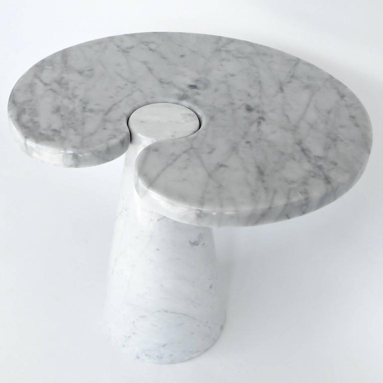 Angelo Mangiarotti Italian white Carrara marble low side table Eros series for Skipper. Excellent condition. Skipper, circa 1971. The low table has a more round plateau than the tall table. The diameter of the pedestal where it interlocks with the